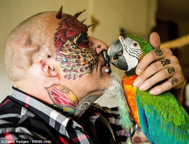 Plastic surgery addict, 58, who has 110 tattoos, 50 piercings and a split tongue to look like his favourite bird has now officially changed his name to Mr Parrotman