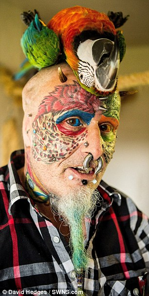 The animal lover has 110 tattoos, 50 piercings and a split tongue - as well as having his ears removed
