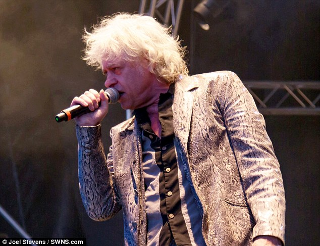 Bob Geldof ranted at the crowd for being attired in 'wall- to-wall' Primark while wearing a 'stylish' fake snakeskin suit